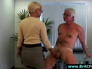 Mature British femdom lady and two younger girls jerk CFNM guy in office