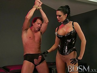 BDSM XXX Slave boy in metal stocks as he receives anal attention