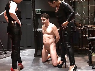 Mistress Noir and Mistress Electra attack the testicles of Andrea Dipre