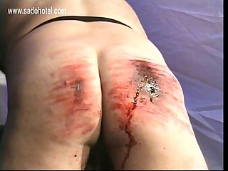 Beautiful mistress with big fake tits spanks dirty slave hard on his ass untill he bleeds