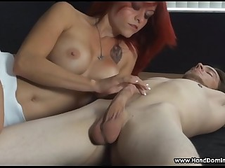 redhead teases cock during femdom bondage handjob