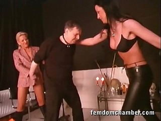 2 femdom in leather pants and boots ballbusting a man