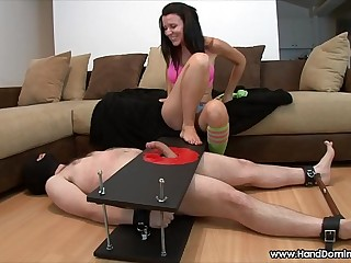 Sadistic mistress unleashes during femdom handjob